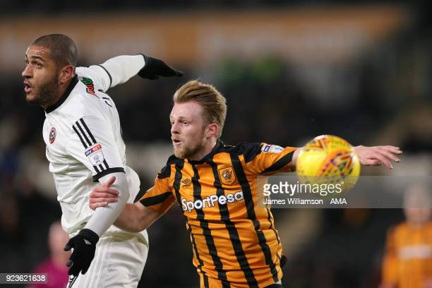 Leon Clarke of Sheffield United and Max Clark of Hull City during the Sky Bet Championship match between Hull City and Sheffield United at KCOM...