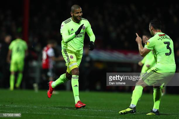 Leon Clarke of Sheffield United celebrates scoring his sides third goal with Enda Stevens during the Sky Bet Championship match between Brentford and...