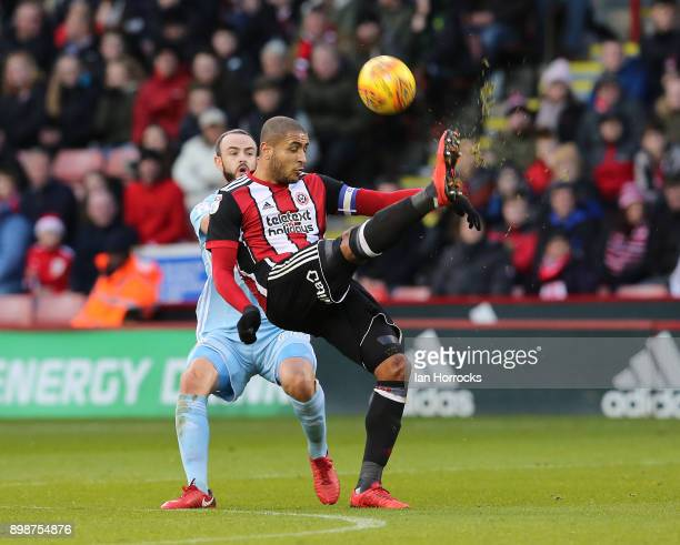 Leon Clarke of Sheffield United clears the ball under pressure from Marc Wilson of Sunderland during the Sky Bet Championship match between Sheffield...