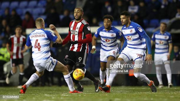Leon Clarke of Sheffield United gets past Joey van den Berg Liam Moore and Tiago Ilori of Reading during the Sky Bet Championship match between...