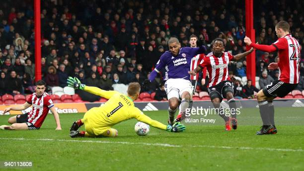 Leon Clarke of Sheffield United has his shot saved by Daniel Bentley of Brentford during the Sky Bet Championship match between Brentford and...