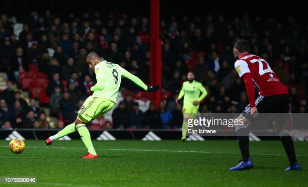 Leon Clarke of Sheffield United scores his sides third goal during the Sky Bet Championship match between Brentford and Sheffield United at Griffin...