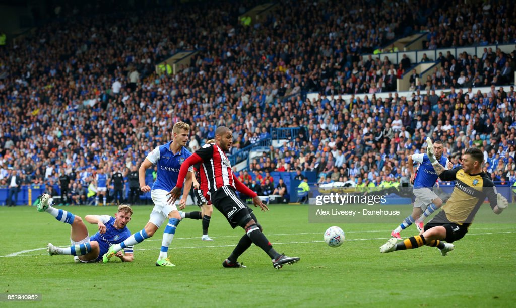 Leon Clarke of Sheffield United scores their fourth goal past Keiren Westwood of Sheffield Wednesday during the Sky Bet Championship match between Sheffield Wednesday and Sheffield United at Hillsborough on September 24, 2017 in Sheffield, England.