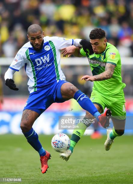 Leon Clarke of Wigan Athletic and Ben Godfrey of Norwich City battle for the ball during the Sky Bet Championship match between Wigan Athletic and...