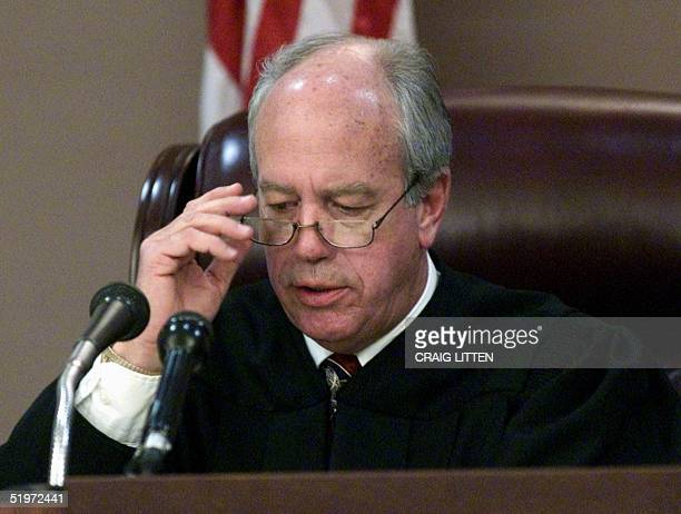 Leon County Circuit Judge N Sanders Sauls adjusts his glasses as he reads his decision in the Gore vs Harris case 04 December 2000 at Leon County...