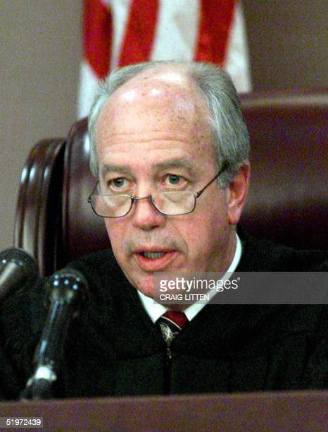 Leon County Circuit Judge N Sanders Sauls reads his decision in the Gore vs Harris case 04 December in Tallahassee Florida Sauls announced his...