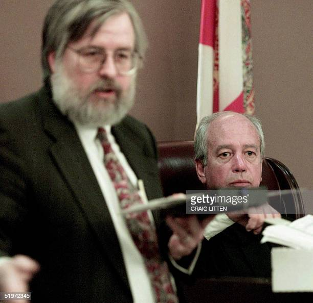 Leon County Circuit Judge N Saunders Sauls listens as witness Kendall Brace president of Election Data Services demonstrates a ballot holder 02...