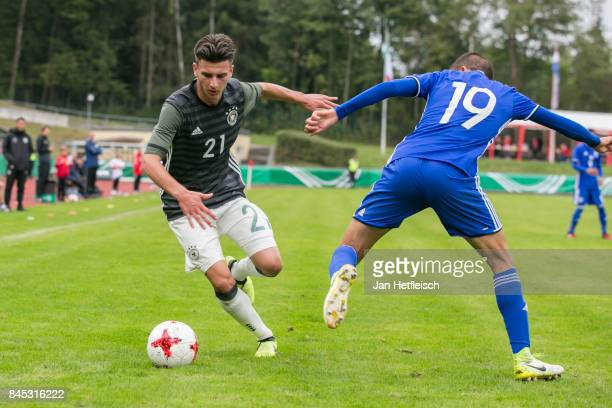 Leon Dajaku of Germany and Liran Cohen of Israel fight for the ball during the 'Four Nations Tournament' match between U17 Germany and U17 Israel on...