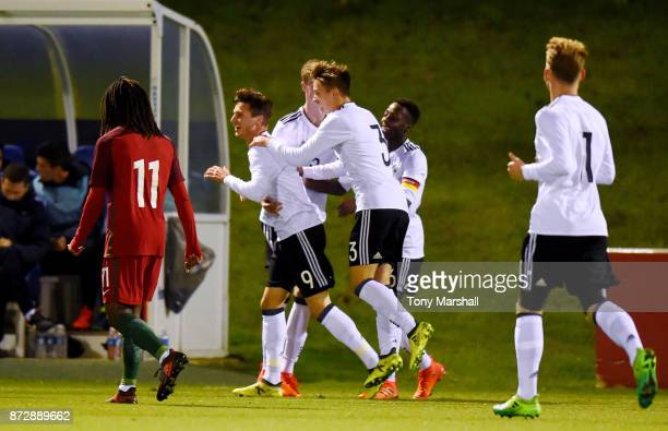 Leon Dajaku of Germany celebrates scoring their first goal during the International Match between Germany U17 and Portugal U17 at St Georges Park on...