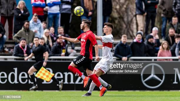 Leon Dajaku of Stuttgart in action against Barbosa da Silva of Freiburg during the DFB Juniors Cup Semi Final match between VfB Stuttgart U19 and SC...