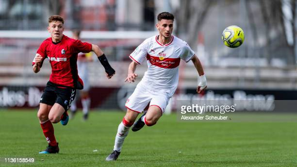 Leon Dajaku of Stuttgart in action against Philipp Treu of Freiburg during the DFB Juniors Cup Semi Final Legal 1 match between VfB Stuttgart U19 and...