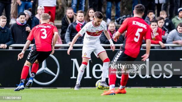 Leon Dajaku of Stuttgart in action against Sascha Risch and Barbosa da Silva of Freiburg during the DFB Juniors Cup Semi Final match between VfB...