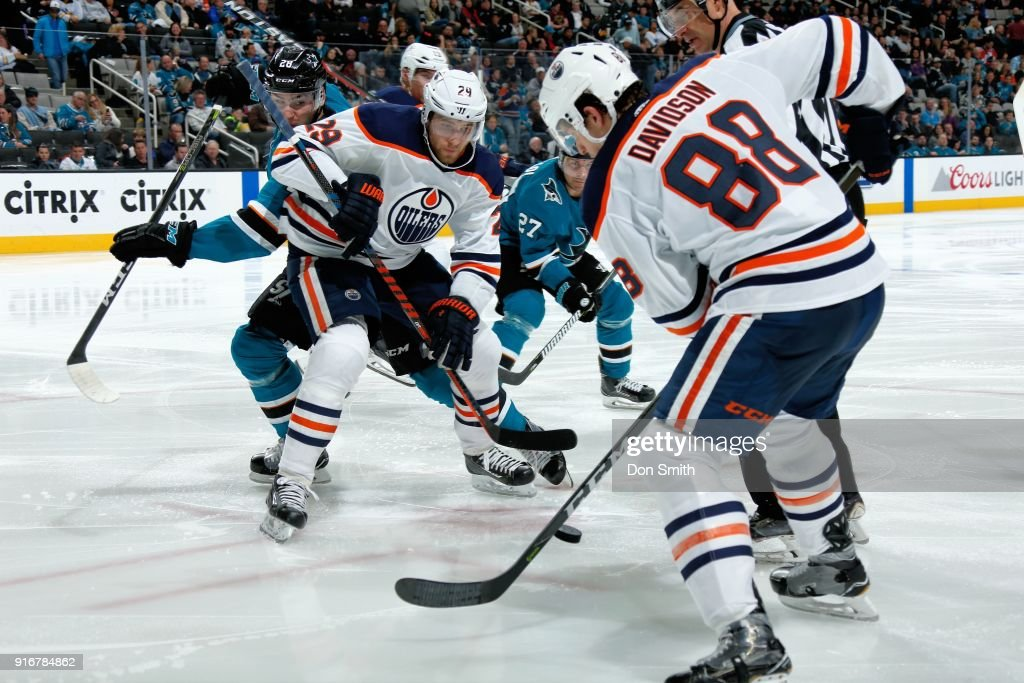 Leon Draisaitl #29 and Brandon Davidson #88 of the Edmonton Oilers keep the puck away from Timo Meier #28 of the San Jose Sharks at SAP Center on February 10, 2018 in San Jose, California.