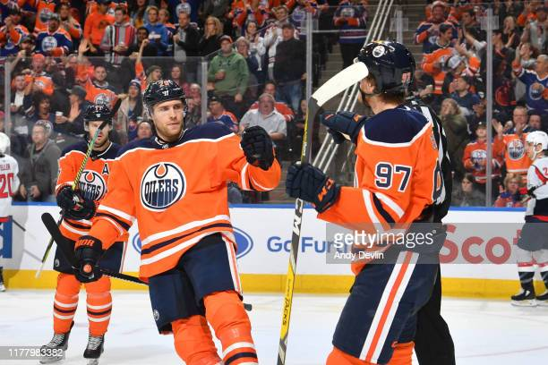 Leon Draisaitl and Connor McDavid of the Edmonton Oilers celebrate after a goal during the game against the Washington Capitals on October 24 at...