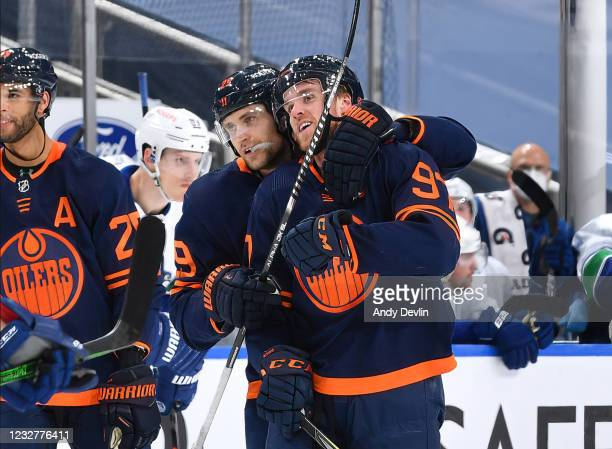Leon Draisaitl and Connor McDavid of the Edmonton Oilers celebrate his 100th point of the season during the game against the Vancouver Canucks on May...