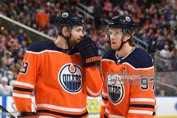 Leon Draisaitl and Connor McDavid of the Edmonton Oilers discuss the play during the game against the Toronto Maple Leafs on December 14 at Rogers...