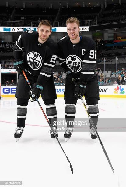 Leon Draisaitl and Connor McDavid of the Edmonton Oilers look on during warmup prior to the 2019 Honda NHL AllStar Game at SAP Center on January 26...