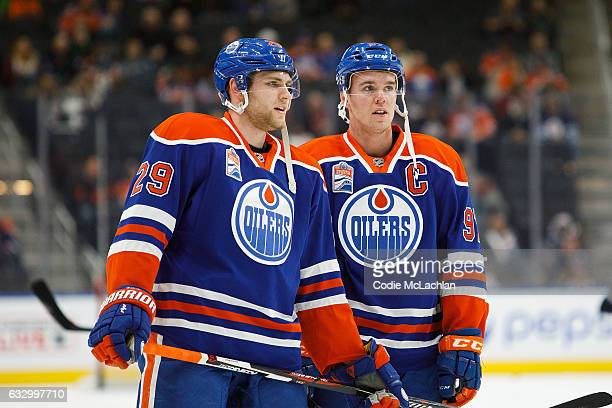 Leon Draisaitl and Connor McDavid of the Edmonton Oilers strategize against the Winnipeg Jets on December 11 2016 at Rogers Place in Edmonton Alberta...