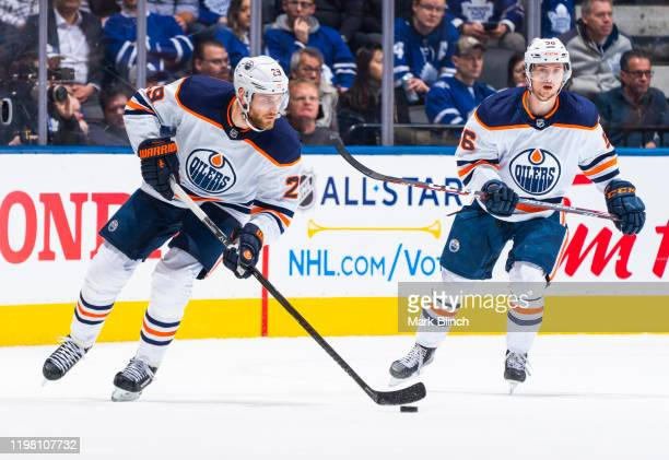 Leon Draisaitl and Kailer Yamamoto of the Edmonton Oilers skate against the Toronto Maple Leafs during the second period at the Scotiabank Arena on...