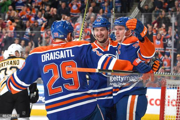 Leon Draisaitl Connor McDavid and Anton Slepyshev of the Edmonton Oilers celebrate after a goal during the game against the Boston Bruins on March 16...
