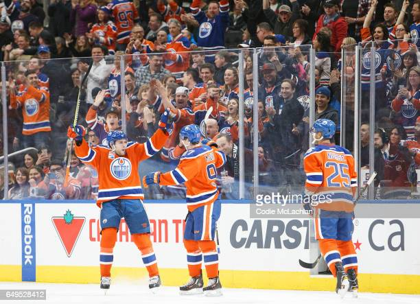 Leon Draisaitl Connor McDavid and Darnell Nurse of the Edmonton Oilers celebrate a goal against the Detroit Red Wings on March 4 2017 at Rogers Place...