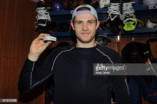 Leon Draisaitl holds up the puck from his first goal in the NHL against the Carolina Hurricanes on October 24 2014 at Rexall Place in Edmonton...
