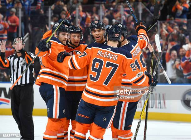 Leon Draisaitl Matthew Benning Darnell Nurse Patrick Maroon and Connor McDavid of the Edmonton Oilers celebrate after a goal during the game against...