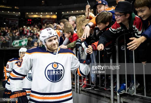 Leon Draisaitl of Edmonton shakes hands with the fans prior to the NHL Global Series Challenge game between Edmonton Oilers and Kolner Haie at...