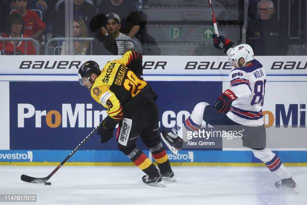 Leon Draisaitl of Germany eludes Christian Wolanin of USA during the international friendly game between Germany and USA ahead of the 2019 IIHF Ice...