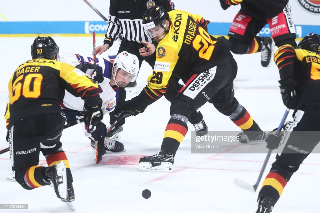 check out b0166 fc3d0 Leon Draisaitl of Germany is challenged by Dylan Larkin of ...