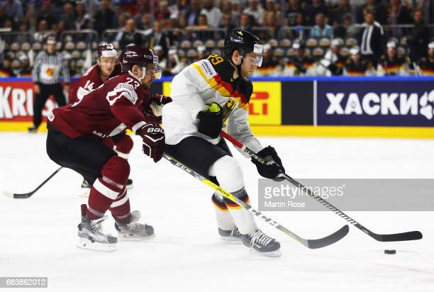 Leon Draisaitl of Germany is challenged by Teodors Blugers of Latvia during the Germany v Latvia match of the 2017 IIHF Ice Hockey World...