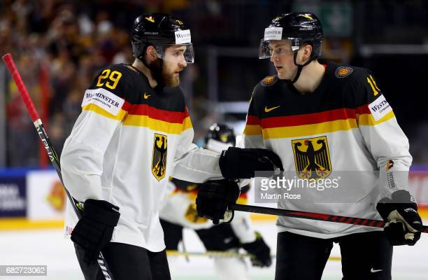 Leon Draisaitl of Germany talks to team mate Konrad Abeltshauser during the 2017 IIHF Ice Hockey World Championship game between Italy and Germany at...