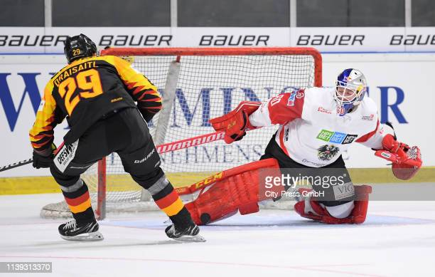 Leon Draisaitl of Team Germany and Lukas Herzog of Team Austria during the game between Germany and Austria at the das StadtwerkDonauArena on April...