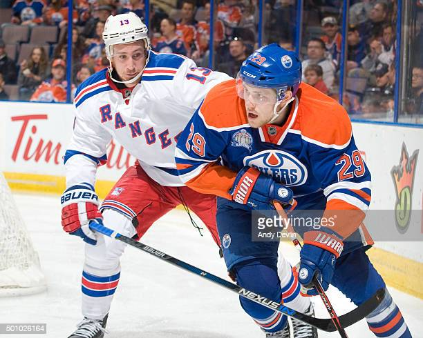 Leon Draisaitl of the Edmonton Oilers and Kevin Hayes of the New York Rangers battle behind the net on December 11 2015 at Rexall Place in Edmonton...