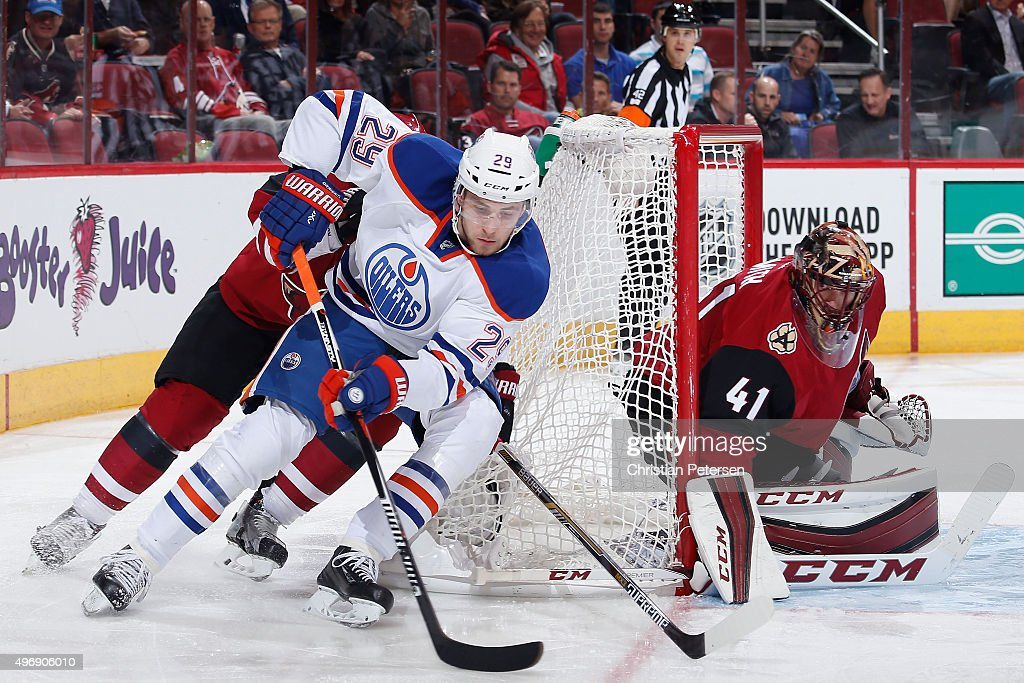 Leon Draisaitl #29 of the Edmonton Oilers attempts a wrap around on goaltender Mike Smith #41 of the Arizona Coyotes during the second period of the NHL game at Gila River Arena on November 12, 2015 in Glendale, Arizona.