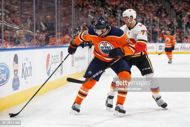 Leon Draisaitl of the Edmonton Oilers battles against Mark Jankowski of the Calgary Flames at Rogers Place on January 25 2018 in Edmonton Canada