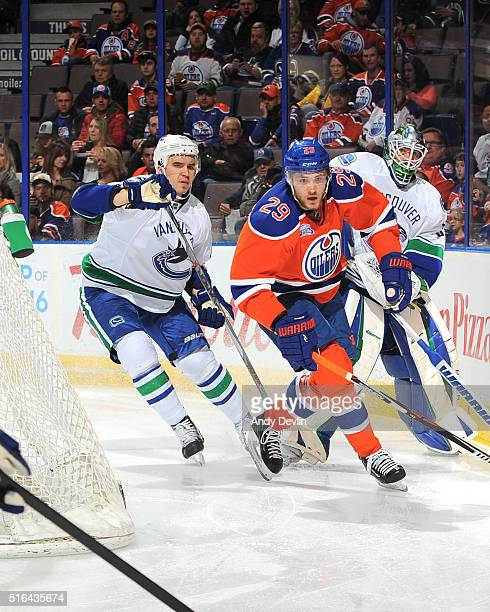 Leon Draisaitl of the Edmonton Oilers battles for the puck against Nikita Tryamkin of the Vancouver Canucks on March 18 2016 at Rexall Place in...