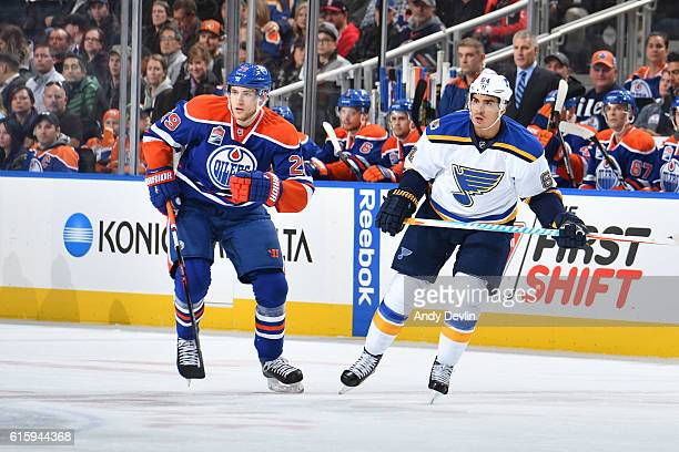 Leon Draisaitl of the Edmonton Oilers battles for the puck against Nail Yakupov of the St Louis Blues on October 20 2016 at Rogers Place in Edmonton...
