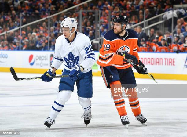 Leon Draisaitl of the Edmonton Oilers battles for the puck against Nikita Zaitsev of the Toronto Maple Leafs on November 30 2017 at Rogers Place in...