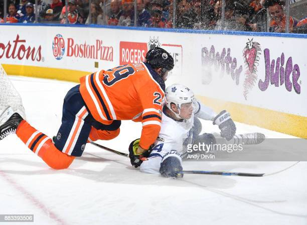 Leon Draisaitl of the Edmonton Oilers battles for the puck against Auston Matthews of the Toronto Maple Leafs on November 30 2017 at Rogers Place in...