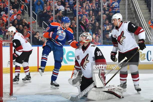 Leon Draisaitl of the Edmonton Oilers celebrates a goal against the Arizona Coyotes Louis Domingue with Luke Schenn andTobias Rieder skating near by...