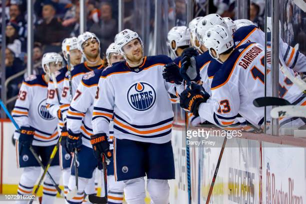 Leon Draisaitl of the Edmonton Oilers celebrates a second period goal against the Winnipeg Jets with teammates at the bench at the Bell MTS Place on...