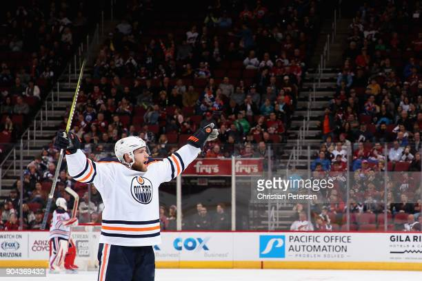 Leon Draisaitl of the Edmonton Oilers celebrates after Darnell Nurse scored a goal against the Arizona Coyotes during the third period of the NHL...