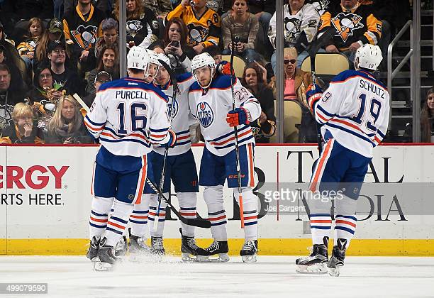 Leon Draisaitl of the Edmonton Oilers celebrates his goal with teammates during the first period against the Pittsburgh Penguins at Consol Energy...