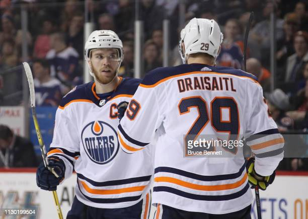 Leon Draisaitl of the Edmonton Oilers celebrates his third period power-play goal with Connor McDavid against the New York Islanders at the Barclays...