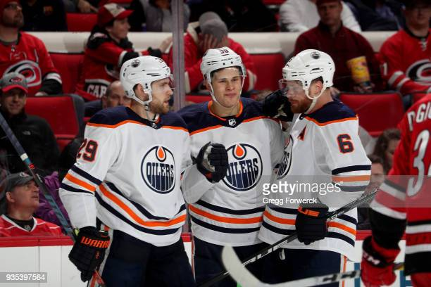 Leon Draisaitl of the Edmonton Oilers celebrates with teammates Jesse Puljujarvi and Adam Larsson after scoring a goal during an NHL game against the...