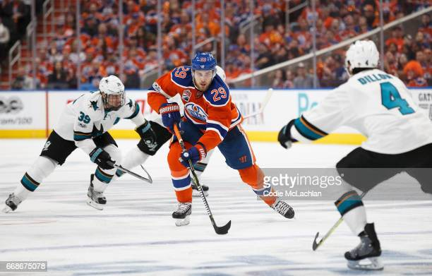 Leon Draisaitl of the Edmonton Oilers is challenged by Logan Couture and Brenden Dillon of the San Jose Sharks in Game Two of the Western Conference...