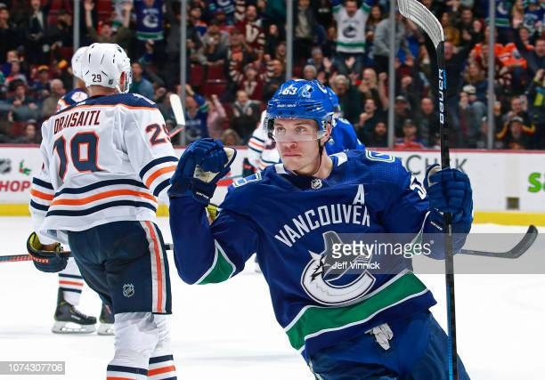 Leon Draisaitl of the Edmonton Oilers looks on dejected as Bo Horvat of the Vancouver Canucks celebrates after winning their NHL game at Rogers Arena...