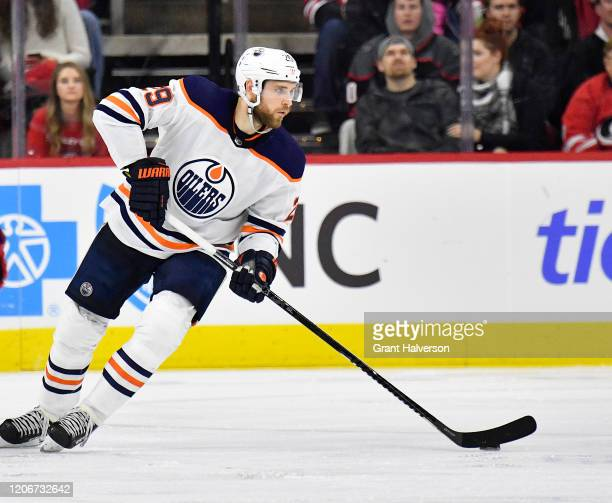 Leon Draisaitl of the Edmonton Oilers moves the puck against the Carolina Hurricanes during the third period at PNC Arena on February 16 2020 in...