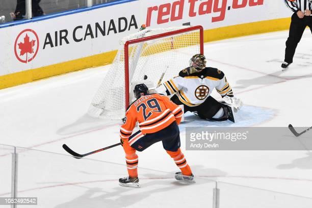 Leon Draisaitl of the Edmonton Oilers scores the overtime goal on Jaroslav Halak of the Boston Bruins on October 18 2018 at Rogers Place in Edmonton...